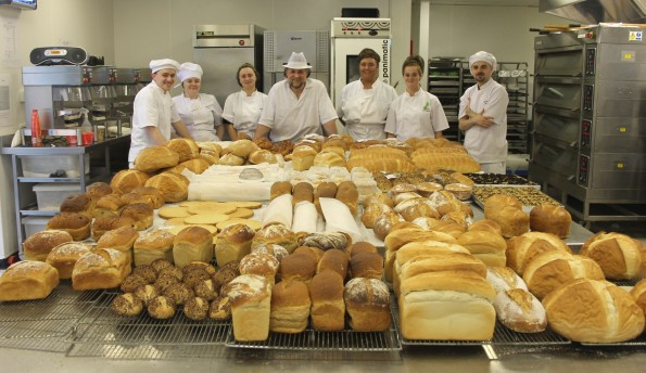Trainees with LYS' Bakery Project display their award winning produce